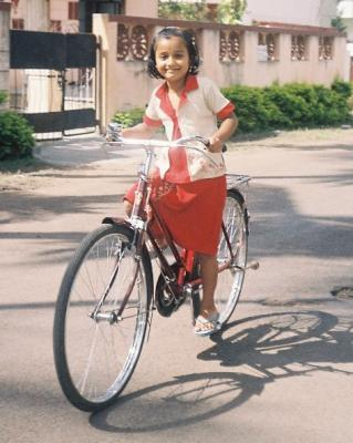 Dhanu on cycle.jpg