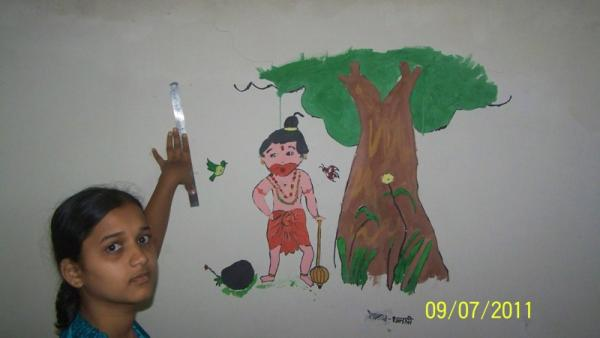 dhanashri & her painting on wall.jpg